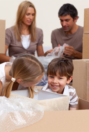 Family getting ready for their local move by packing moving boxes